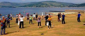 Qigong Practice On The Shore. Photo: Sharon Leighton